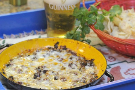 Queso Fundido goes great with a  cold beer or a margarita.
