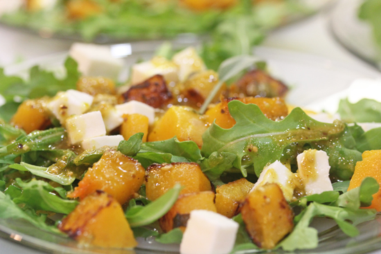 Pumpkin Salad with Fresh Mozzarella and Pistachio Pesto served over fresh arugula.