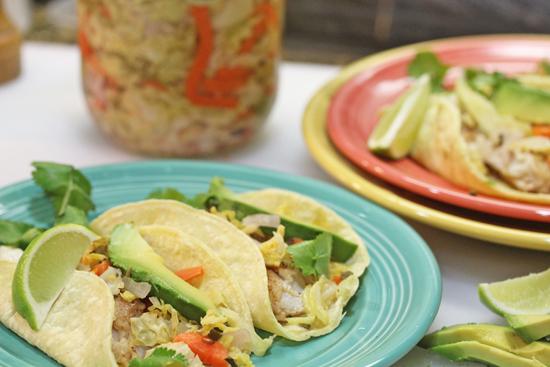 Curtido tops Fish Tacos.