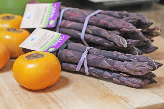 Purple Asparagus and Fuyu Persimmons from Frieda's Produce.