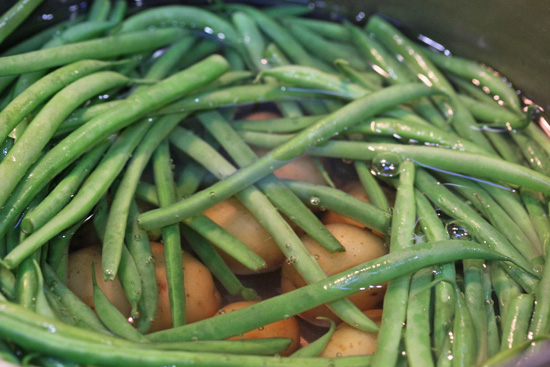 Green Bean, Potato, Tomato and Pesto Salad recipe from FreshFoodinaFlash.com.