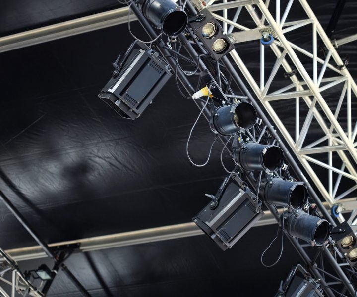 Spotlights and metal beam on stage before the show