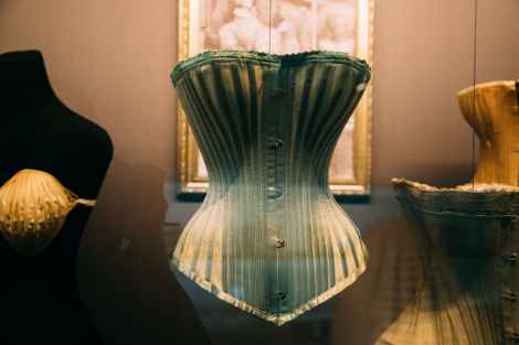 historical female corset in showcase on exhibition