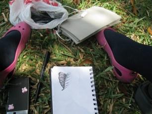 Versia Harris sketching on the lawn