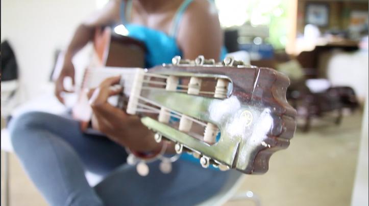 Shea Rose playing the guitar