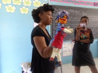 Cherise demonstrating one of her puppets.