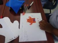 Designing puppets.