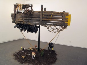 Nyugen Smith, Untitled (Boat #1), Found wood, rope, metal, wire, canvas, earth, live plants, brick, inflated latex gloves, 2013