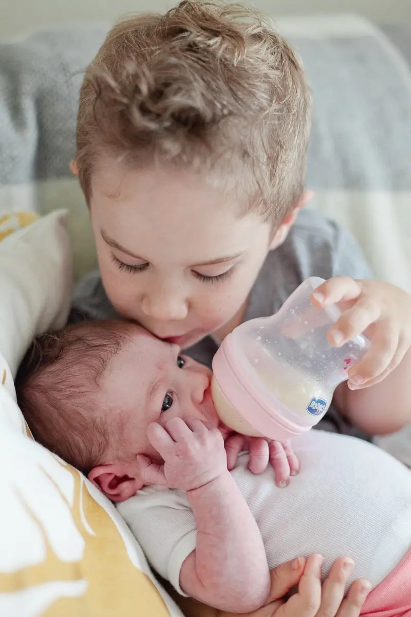 Giving mama a break and giving a bottle to newborn baby Aria