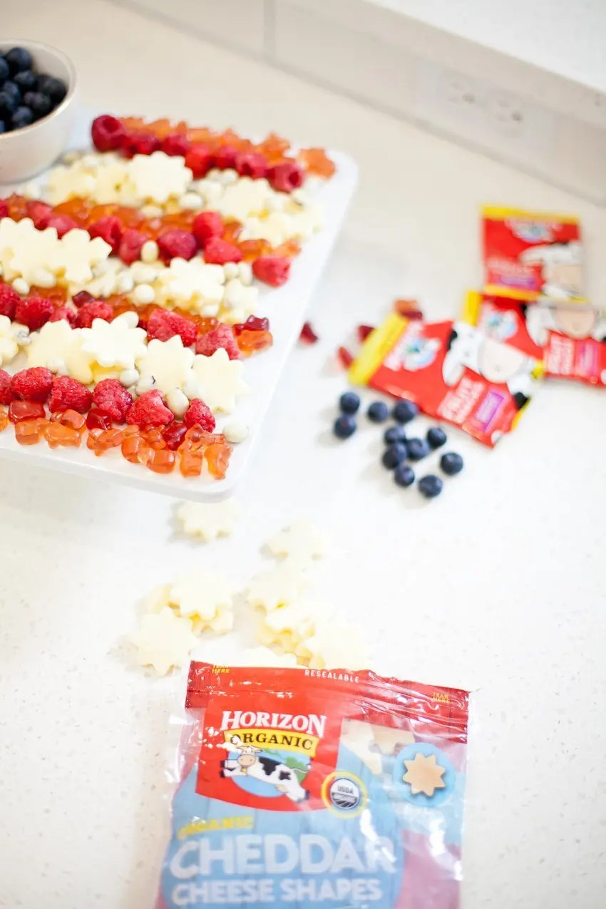 A patriotic flag snack tray that will impress your guests and get you in an Americana mood while you feel good about what you're serving with these healthier options!
