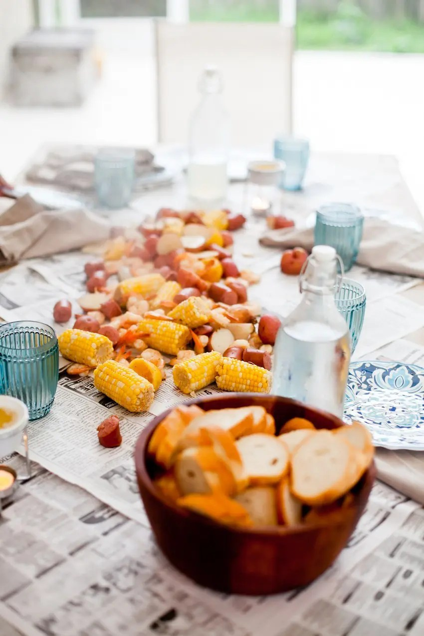 How to host a seafood boil for easy summer entertaining! Think a seafood boil seems like a lot of effort to pull off? We did too... until our first one! Read on for our simple tips to create your own summer seafood affair.