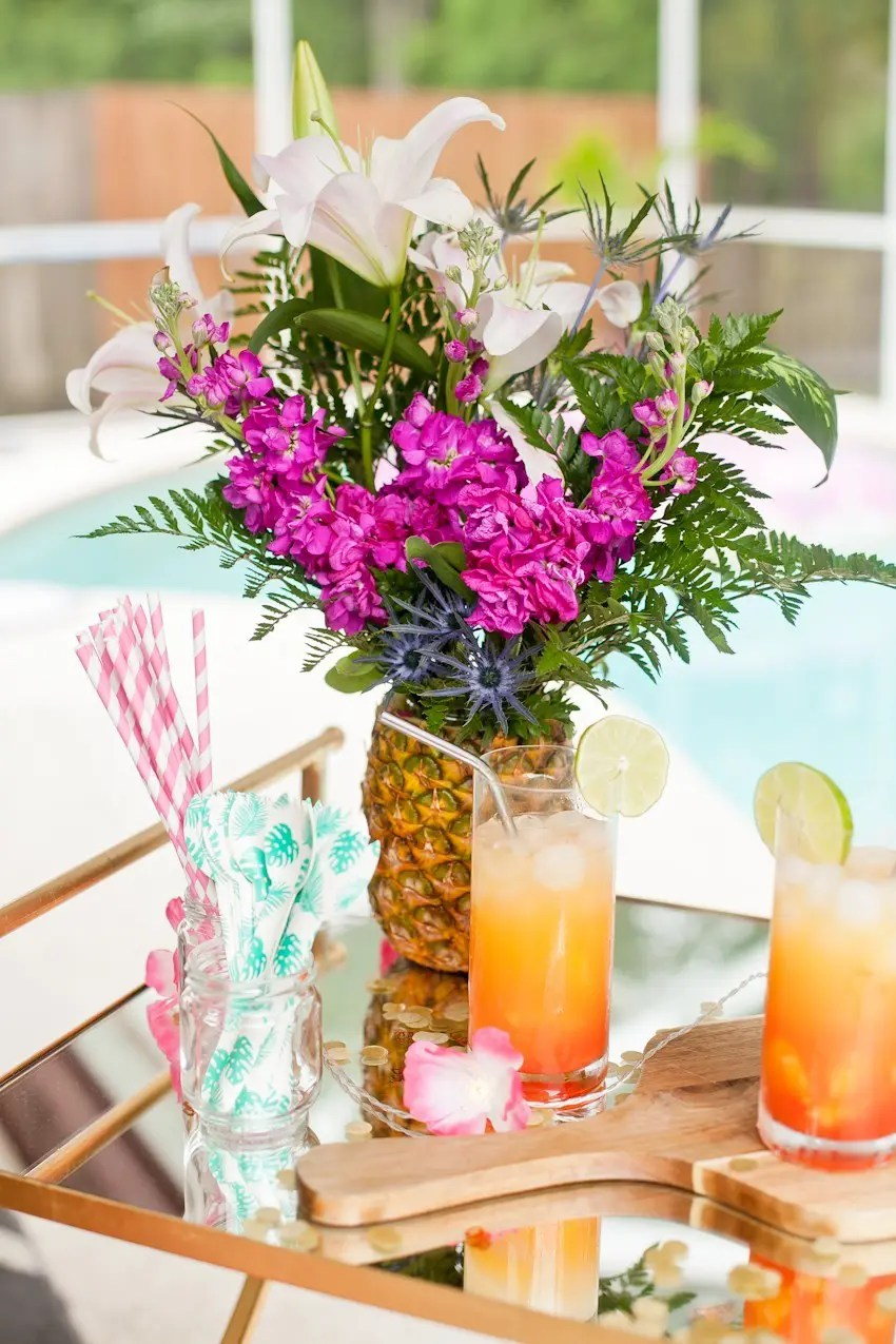 How to make a tropical pineapple floral arrangement fresh mommy blog this diy pineapple vase pineapple flower arrangement for garden parties or a summer tropical fete reviewsmspy
