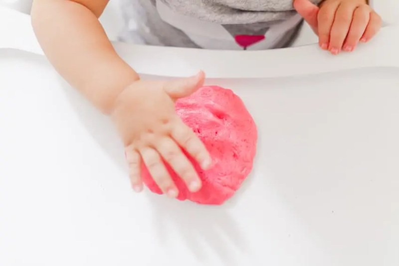 Colorful rainbow play dough that we turn into deliciously fruity cookies! It's a recipe and activity in one!
