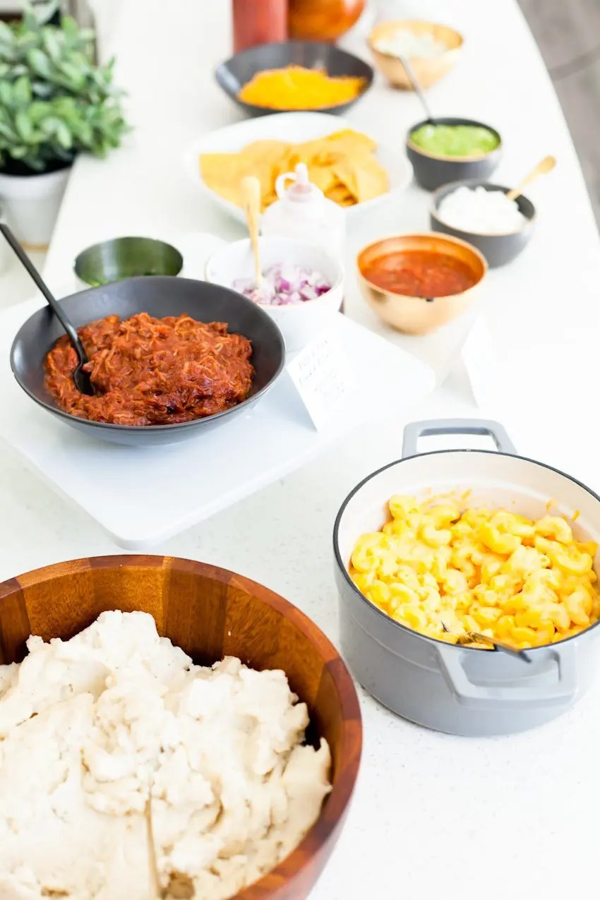 Between the last few lazy weekends of football we have left and the holiday season upon us, we've no shortage of entertaining at our doorstep. Welcome guests with open arms once you set up with a simple Mashed Potato and Mac and Cheese Bar that will rival any game on the big screen!
