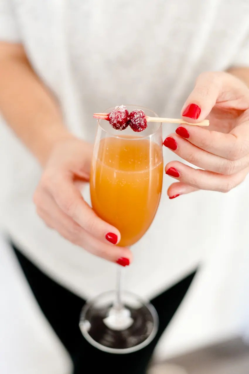 A mimosa bar makes a perfect addition to breakfast or brunch, and makes it easy on the hostess as guests can happily serve themselves. Just a small tweak makes it family-friendly and set out beautiful sugared cranberries for the perfect holiday topper!