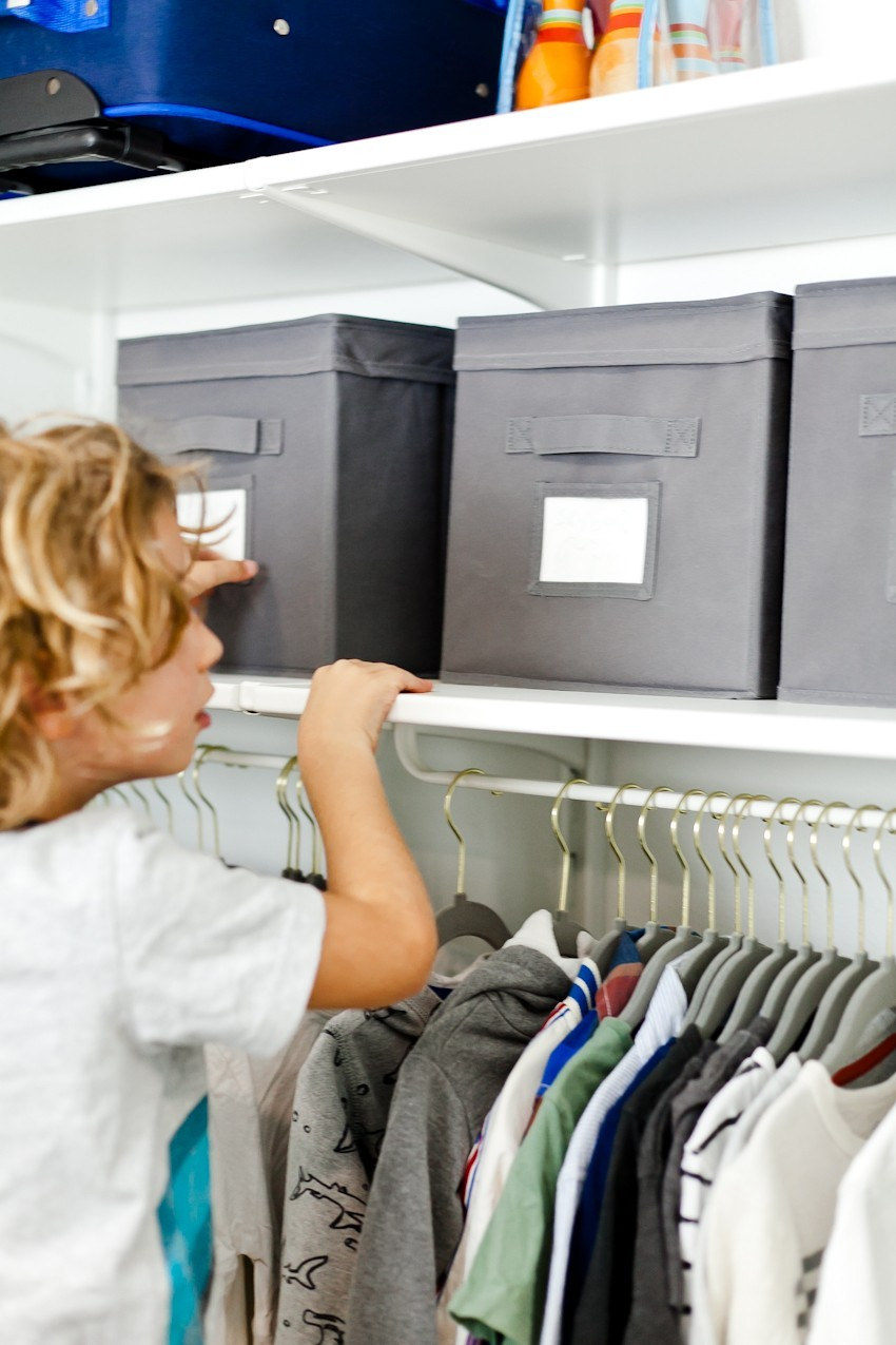 Kids Closet Organization ideas and DIY for a small shared closet! Using neutral white and gray, it's perfect for a boy or girl. Tips by popular Florida mom blogger Tabitha Blue of Fresh Mommy Blog