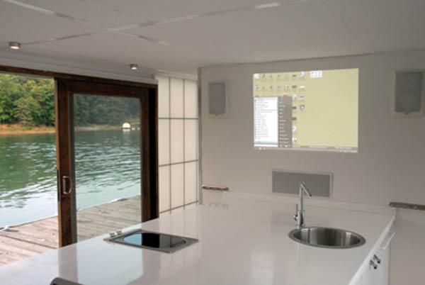 5 metroship modern kitchen with computer projection Contemporary Luxury Houseboat with a Loft Style Interior