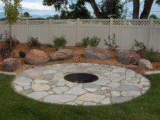 Backyard Patio With Stone Firepit 13