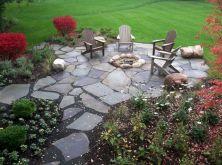 Backyard Patio With Stone Firepit 3