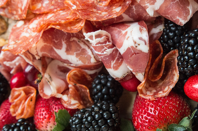 Meet Your New Skill: Crafting a Seasonal Charcuterie Board. Springtime fruit and vegetables pair deliciously with locally-produced charcuterie and simple homemade nut crackers for a simple yet lavish spread. Click to read more tips on GrokGrub.com