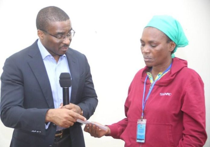 Chief of Staff to Gov. Ifeanyi Okowa presenting a cheque to the mother of the late DELSU student 768x537 1