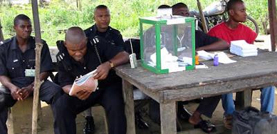 Policemen guarding electoral materials