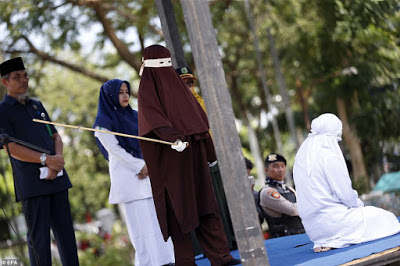 PHOTOS: Woman Is Caned Publicly For Committing Adultery