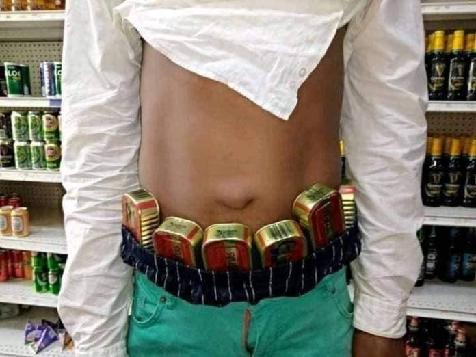 Man Pretending To Be Shopping Caught With Stolen Items Around His Waist (Photos)