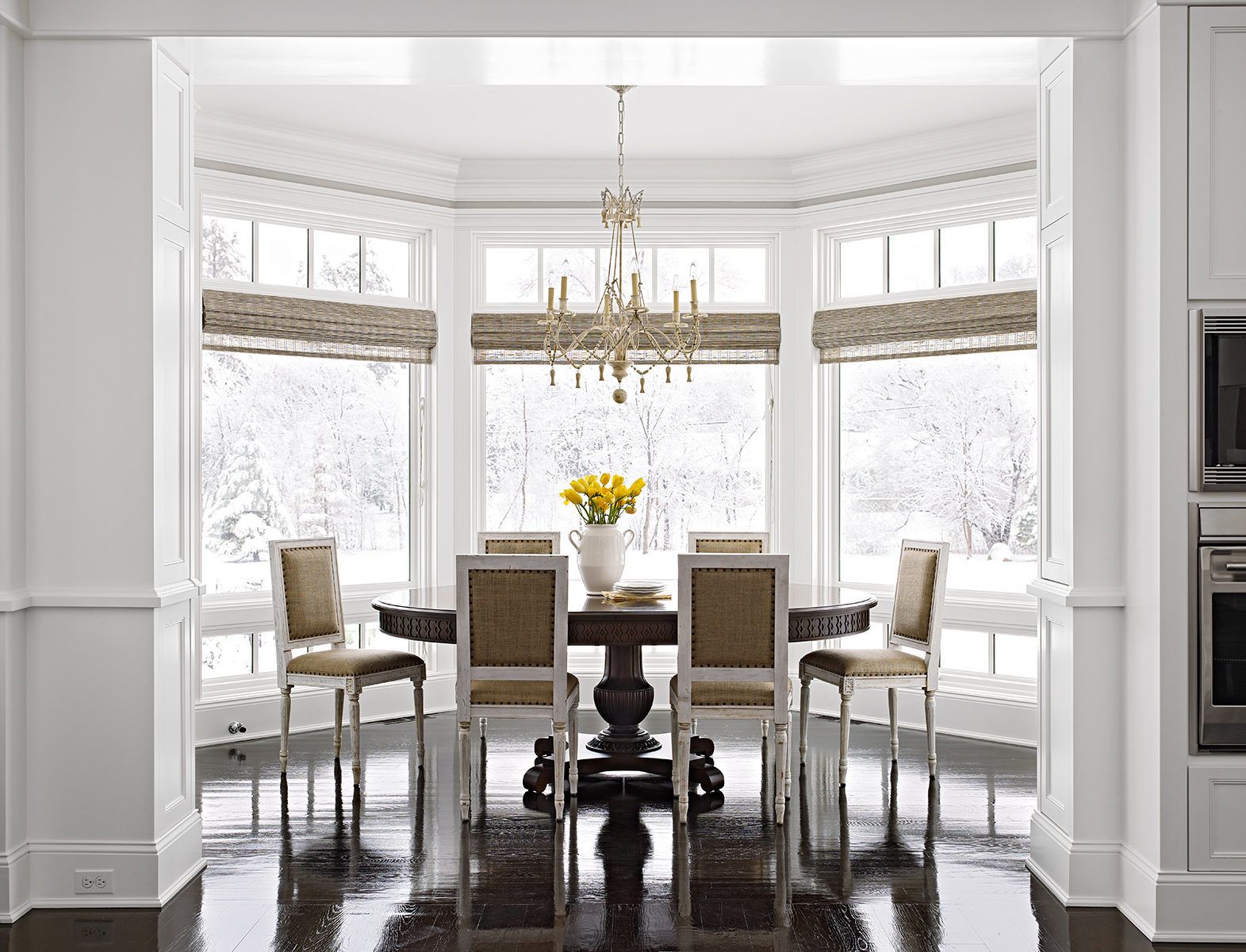 dining room woven shades bay windows