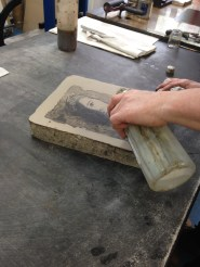 Etching the stone.