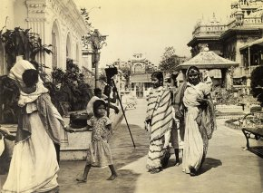 Indian women, dressed in the native Saree, return from prayer at Jain Temple. Little girls wear Europeandress usually until the marriage age, although some mothers like to dress the little girls in Sarees.