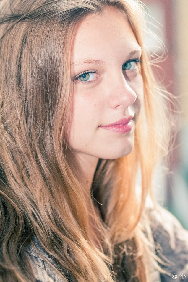 With green eyes and long blond hair