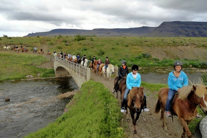 Horseback and caving friend in iceland