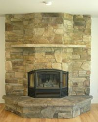 An RSF Delta clean face fireplace installed on a flat wall.