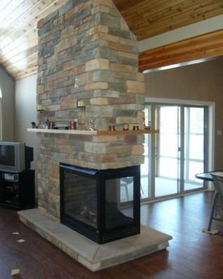 The Kozy Heat Trimont by friendlyfires.ca - a see thru gas fireplace that can also be a pier fireplace.
