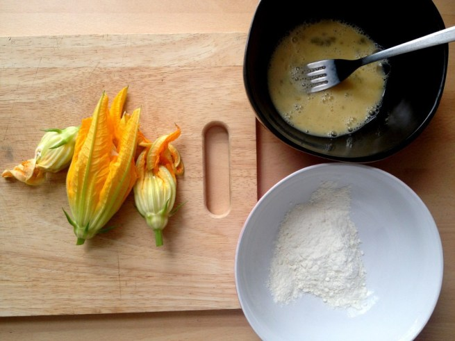 Dip the flowers in egg and flour