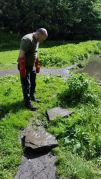 Jules digging the Well capping stones out of the Brook,