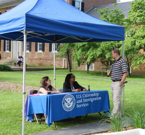 Friends of Chatham member Bill Baer speaks with members of the U.S. Citizenship and Immigration Services in the garden.