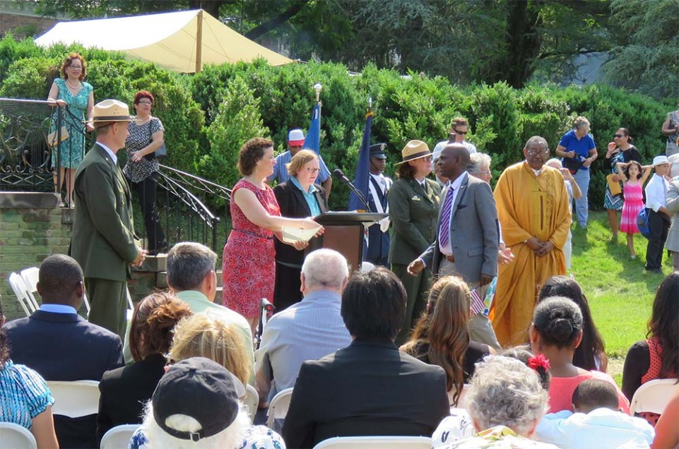 Sarah Taylor, director of the Washington, D.C., office of the U.S. Citizenship and Immigration Services presents citizenship documents to our newest citizens as Chief Historian John Hennessy and Park Superintendent Lucy Lawliss look on.