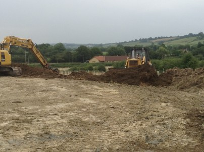 Pushing topsoil back...
