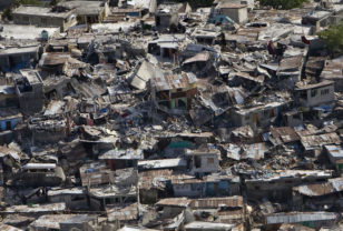 A poor neighbourhood shows the damage after an earthquake measuring 7 plus on the Richter scale rocked Port au Prince Haiti just before 5 pm yesterday, January 12, 2009.