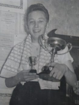 Pete Shorey with his swimming trophy c 1940s