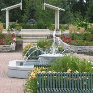 Fountain and bench in the Muriel Sahlin Arboretum
