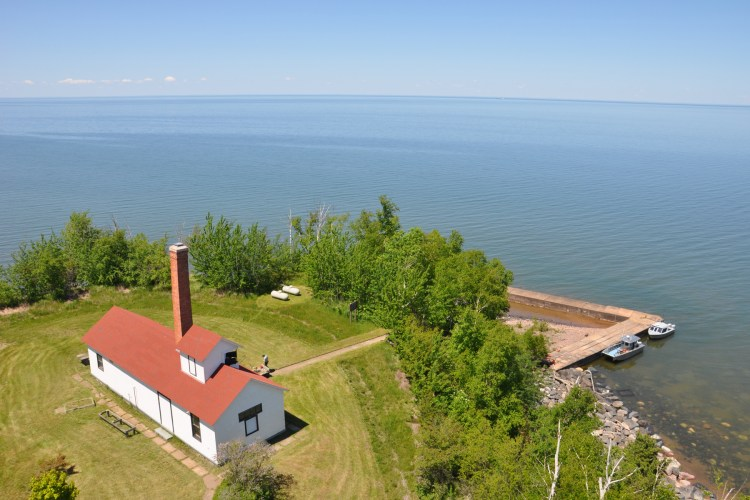 An aerial view of the fog building from the top of the lighthouse