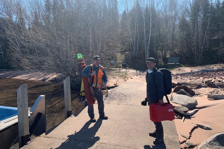 A survey crew arrives at Presque Isle to make measurements in preparation for construction