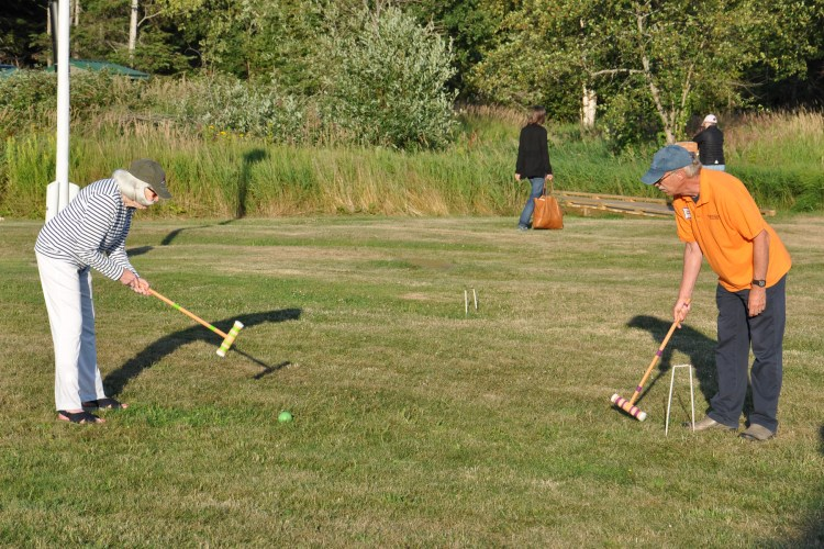 Playing croquet on the lighthouse lawn