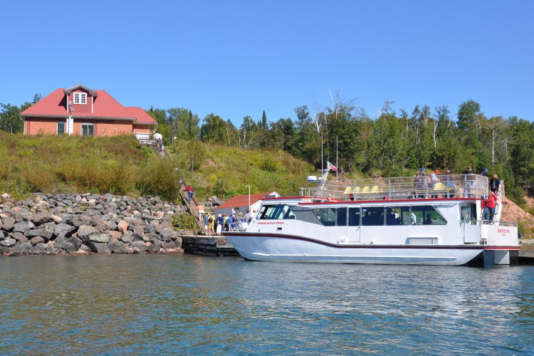 A tour boat stops at Raspberry Island