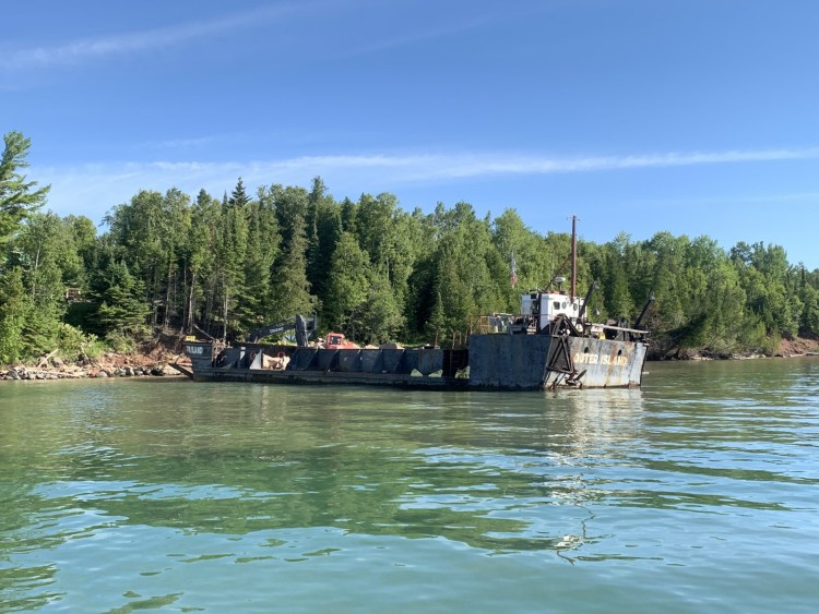 The LCT Outer Island delivers rock and equipment to Sand Island