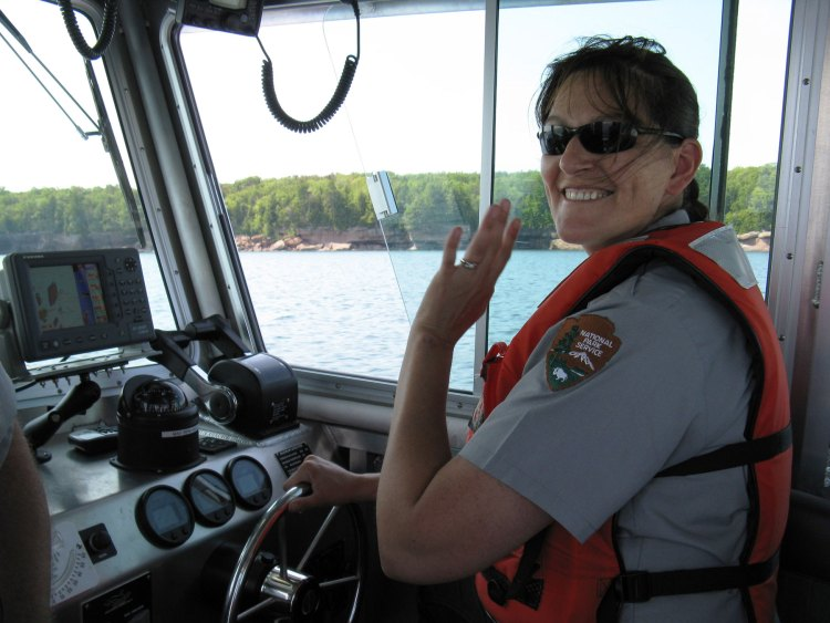 Christy piloting one of the park boats