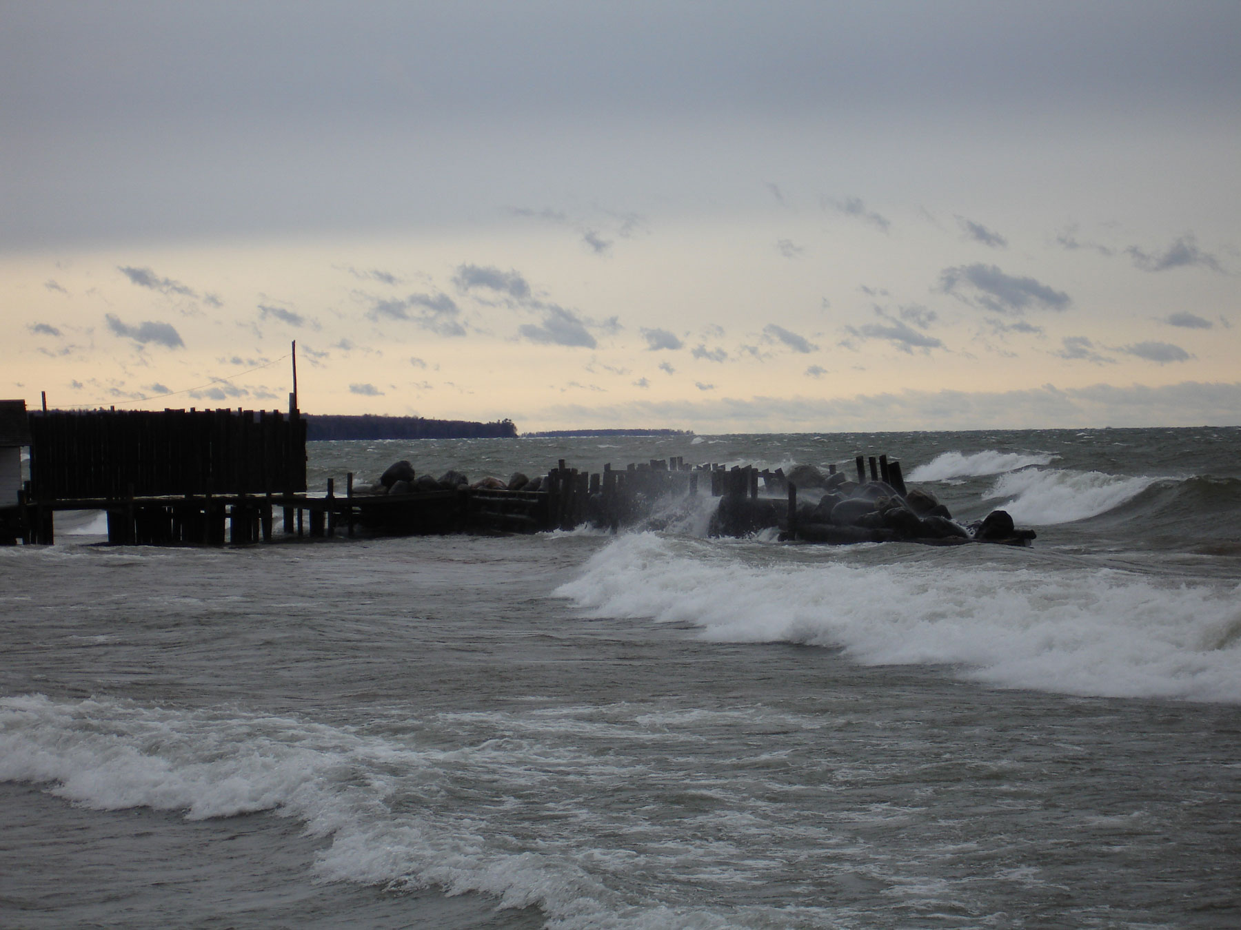 storm waves rolling into the Hokenson dock at Little Sand Bay
